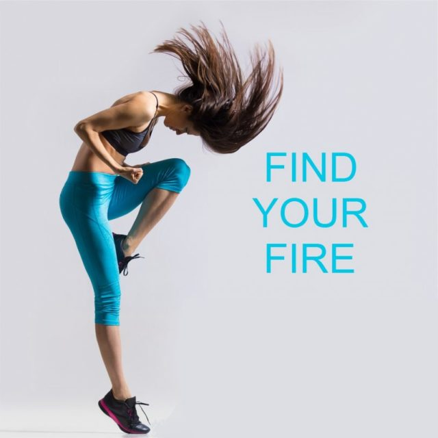 "Beautiful young fit modern dancer lady in blue sportswear warming up working out dancing with her long hair flying full length studio image on gray background. Motivational phrase ""Find your fire"""