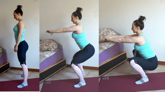 girl squats with a resistance band