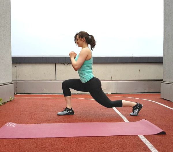Girl performing the lunge exercise.