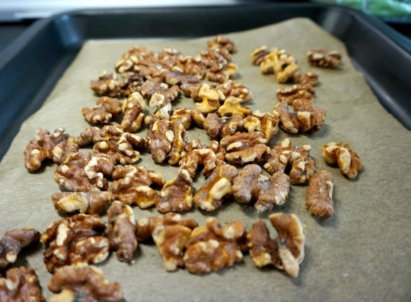 Roasted walnuts in a non stick tray.