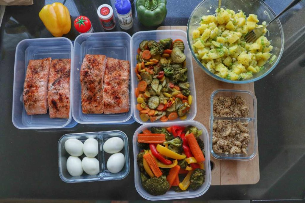 meal prep meals with salmon and veggies