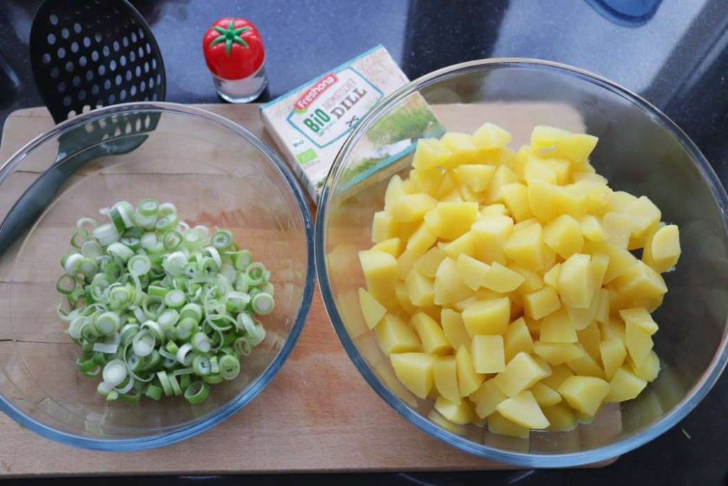 ingredients for potato salad - potatoes, green onions, dill - part of a meal prep