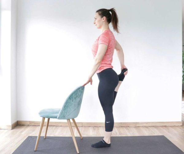 Standing quad stretch demonstration to relieve tight hip flexors.