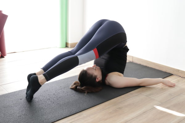 Plow pose for lower back stretching.