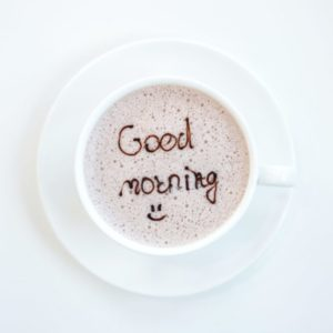 """Coffee cup with a """"Good morning"""" note"""